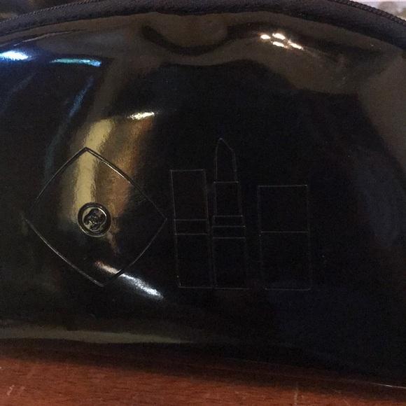 CHANEL Handbags - CC Chanel Patent makeup bag